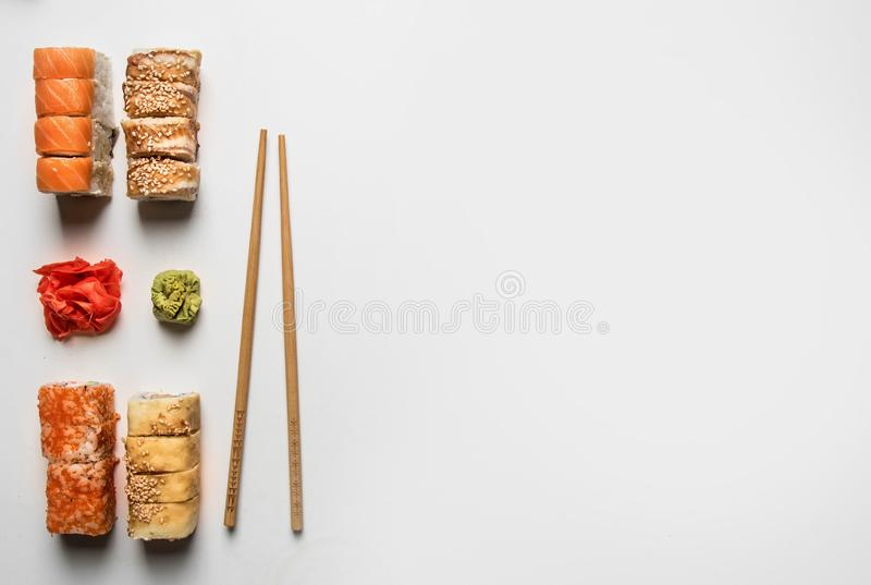 Set of delicious sushi with ginger and wasabi on a white background, space for text royalty free stock images