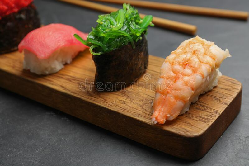Set of delicious sushi on table, closeup. Set of delicious sushi on grey table, closeup royalty free stock image