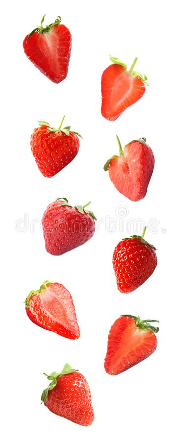 Set with delicious sweet strawberries. On white background stock image