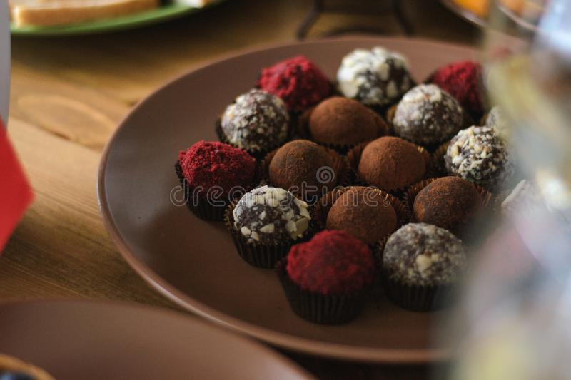 Set of delicious truffle chocolates on the holiday table stock photography