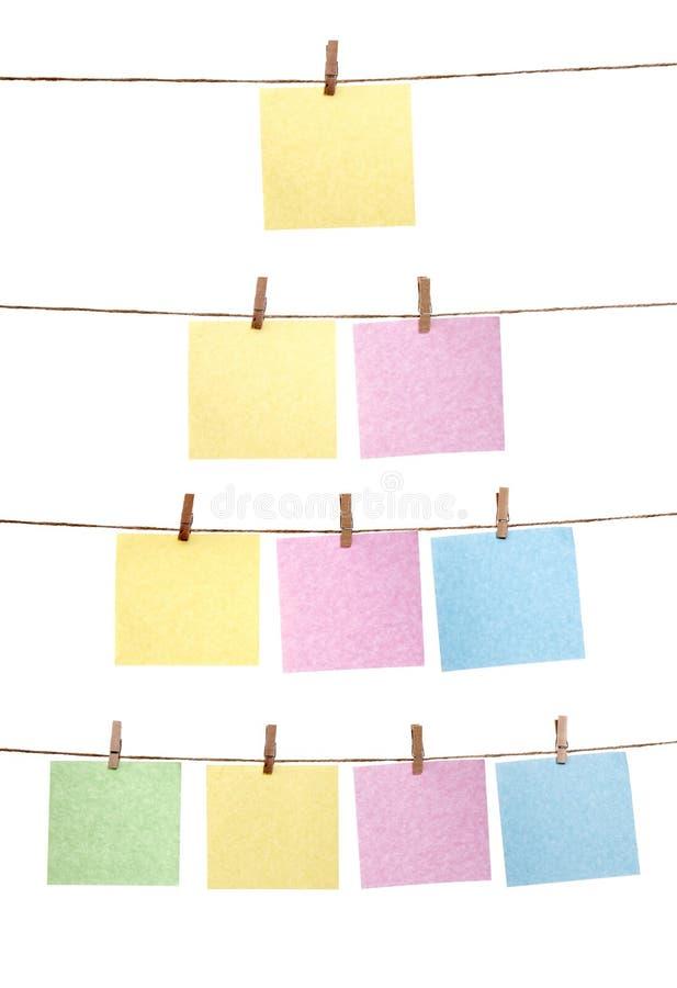 Set der hängenden Papieranmerkung stockbild
