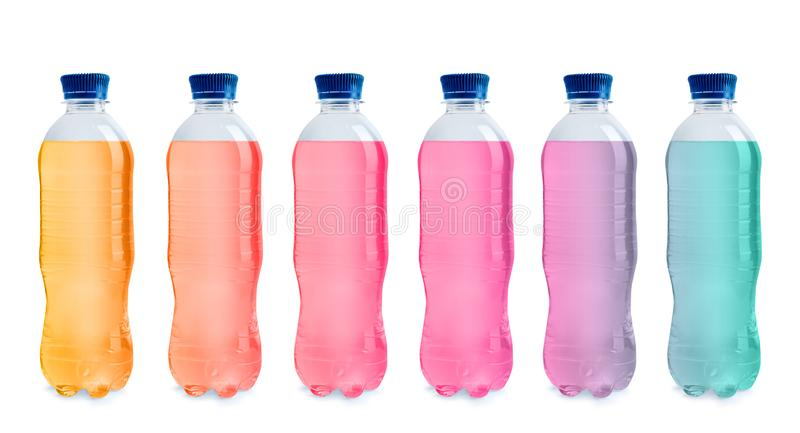 Set with different bottles of colorful drinks royalty free stock photos