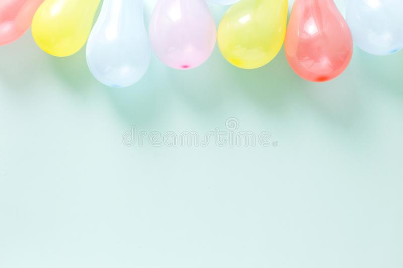 Colorful balloons Pattern decoration party pastel blue background flat lay top view royalty free stock image