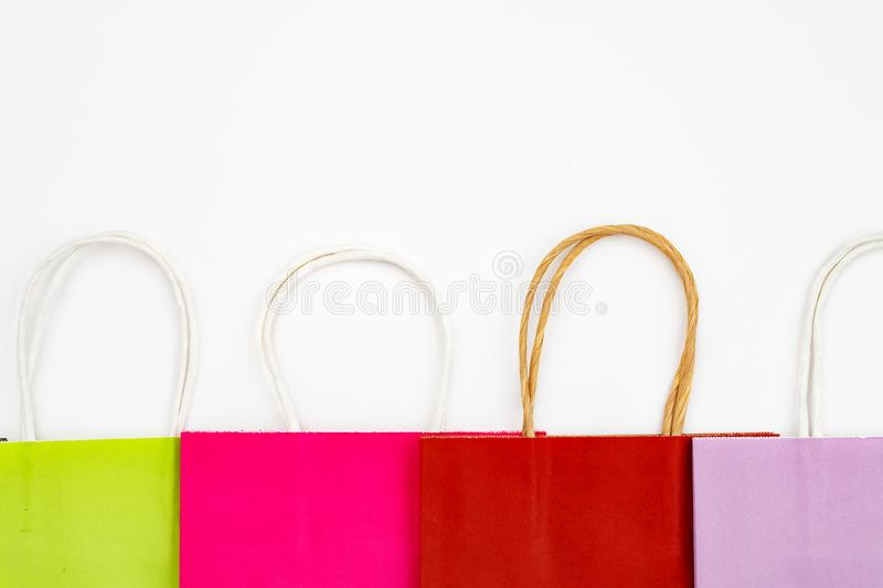 Set of different colour shopping paper bags on a white background, top view, flat. Colorful, buy, gift, present, purchase, retail, sale, package, container royalty free stock image