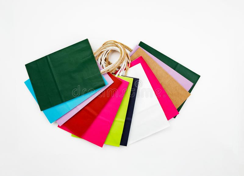 Set of different colour shopping paper bags on a white background, top view, flat. Colorful, buy, gift, present, purchase, retail, sale, package, container royalty free stock images