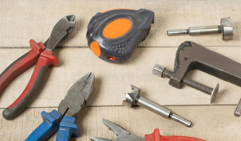 Set of different construction tools on wooden background.Construction concept. royalty free stock photo