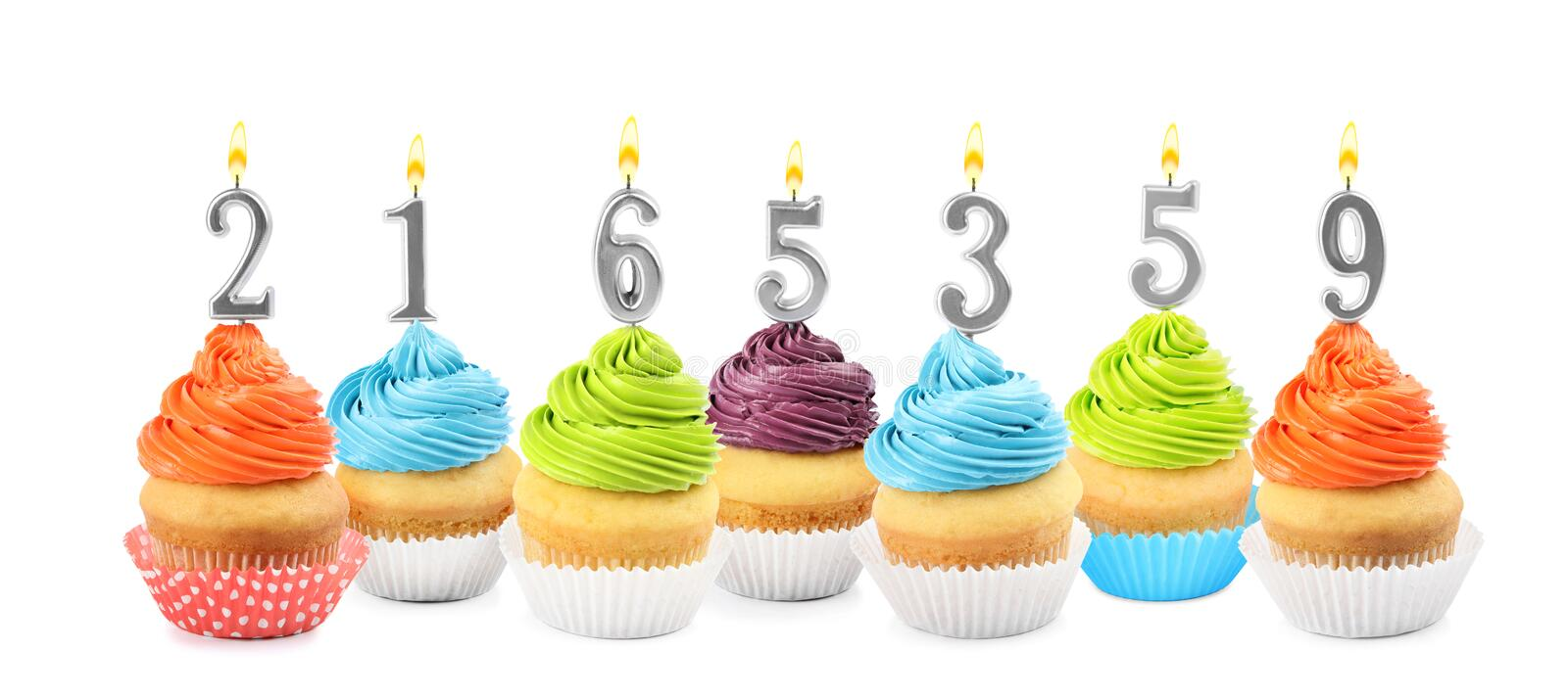 Set of different delicious birthday cupcakes with burning candles on white background. Banner design stock images