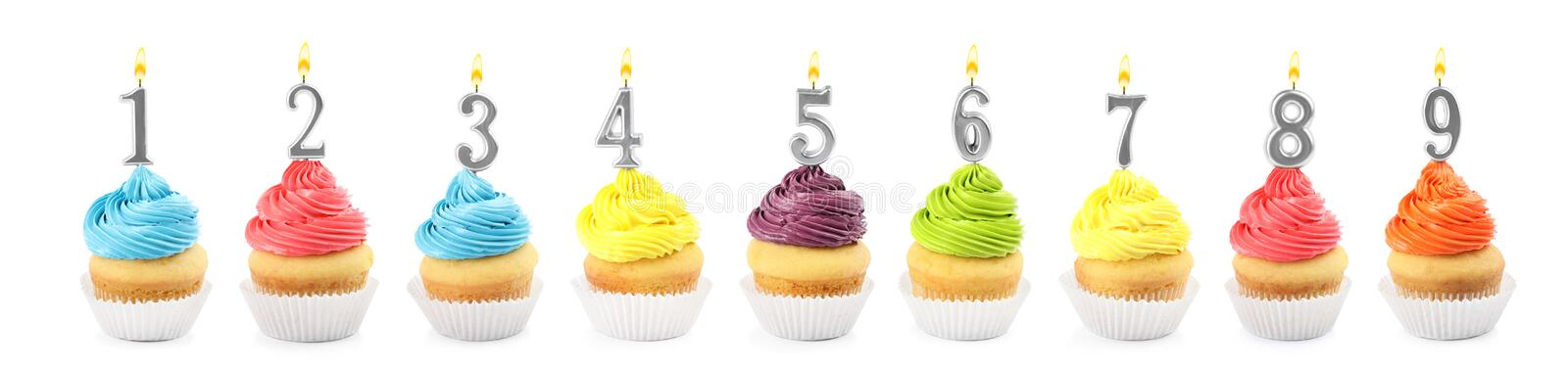 Set of different delicious birthday cupcakes with burning candles on white. Banner design royalty free stock image