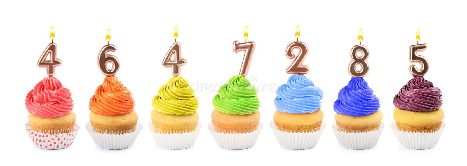 Set of different delicious birthday cupcakes with burning candles on white background. Banner design stock photography