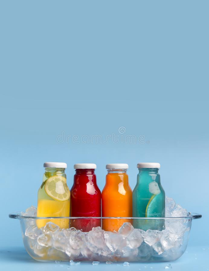 Set of different detox drinks with ice on light blue background royalty free stock images