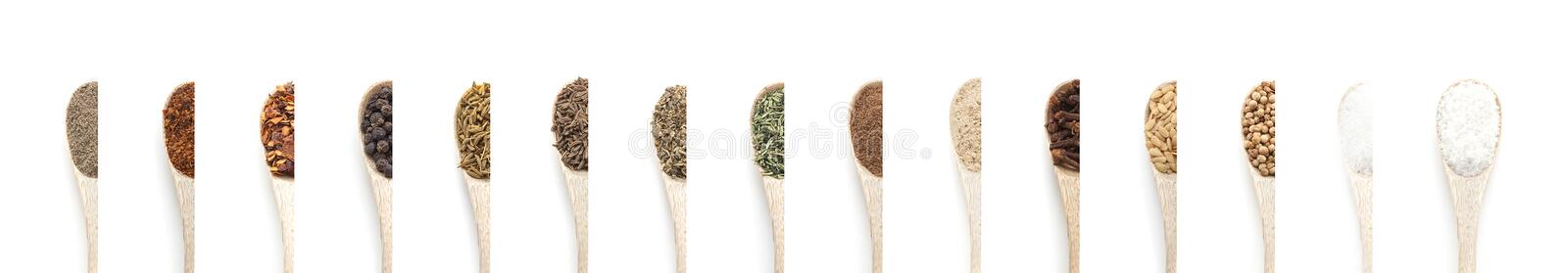 Spices in spoons isolated on white background. Top view. royalty free stock photography
