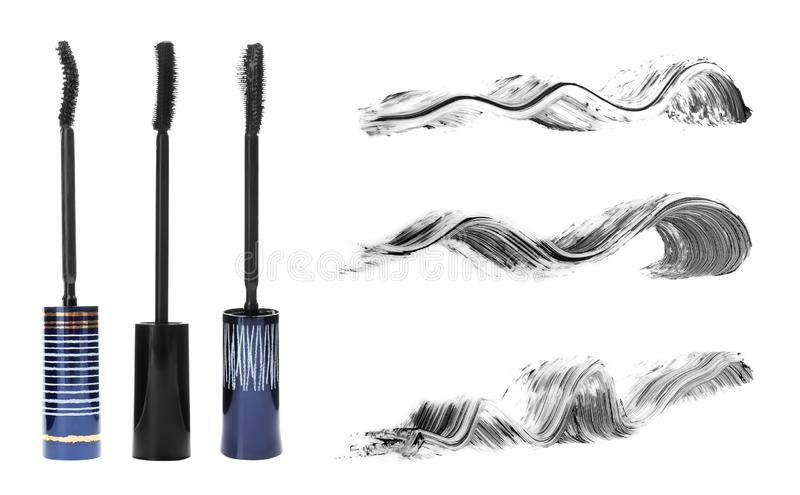 Set with different eyelash mascara wands. And strokes on white background royalty free stock photos