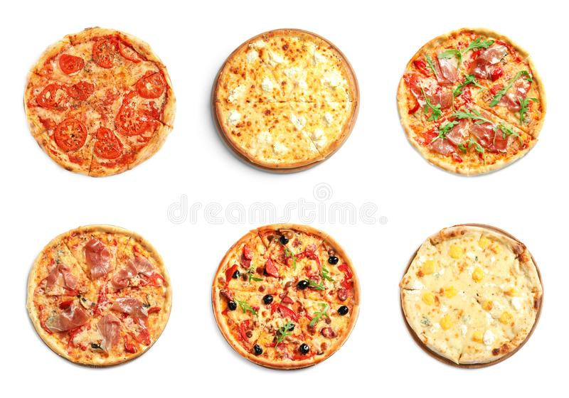 Set of different hot pizzas with delicious melted cheese on white background stock images