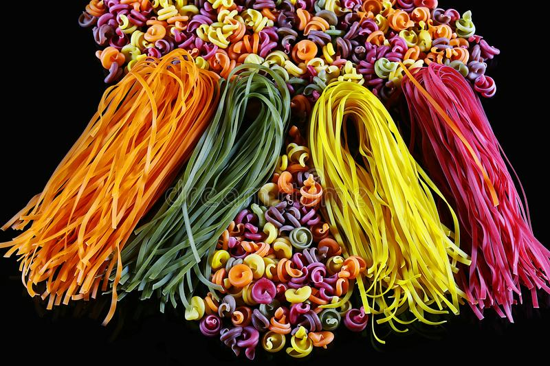 Set of different kinds of colorful Italian pasta, on a black background, healthy food concept, close-up stock photo
