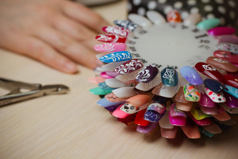 Set of different nail polish colours on palette. Nails art accessories stock images