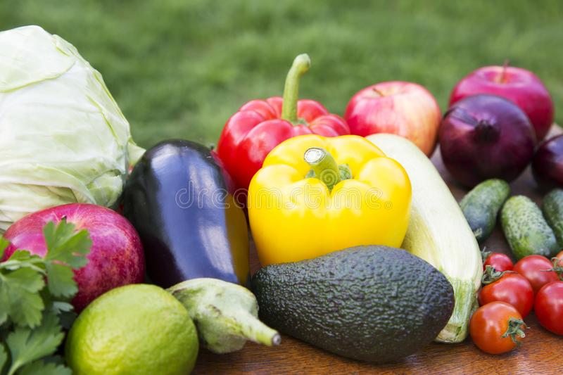 Set of different organic raw fruits and vegetables on wooden rustic table. Side view. stock photos