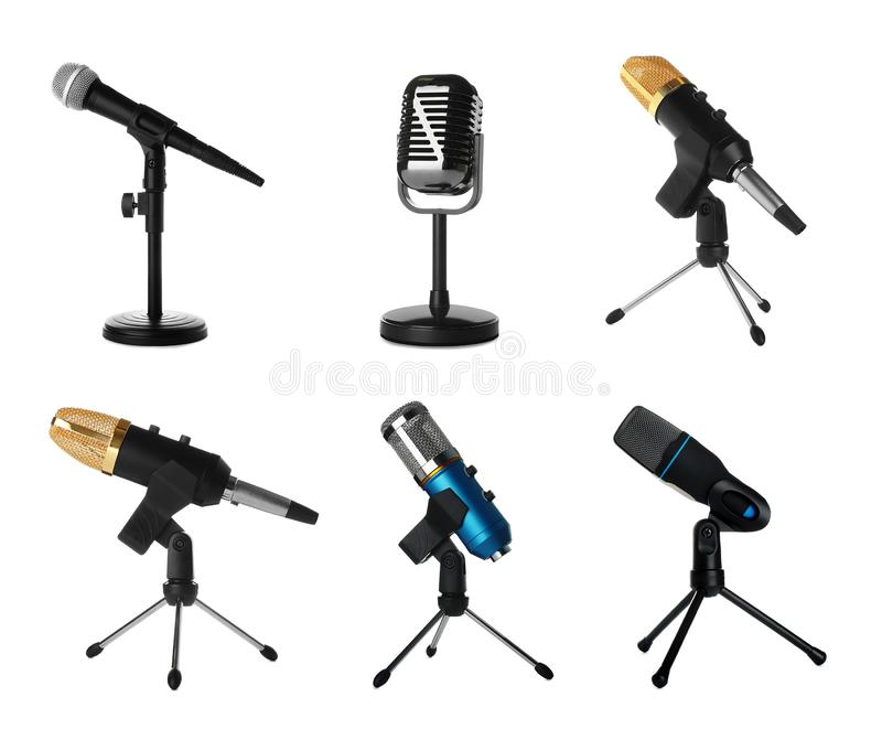 Set of different professional microphones in holders. On white background stock illustration
