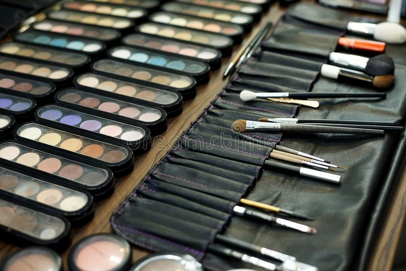 A set of various shadows, brushes and cosmetics for makeup stock photo