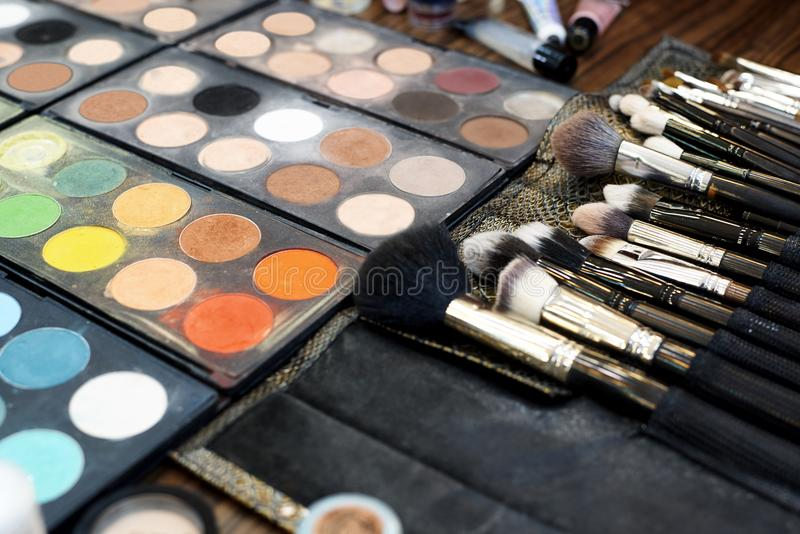 A set of various shadows, brushes and cosmetics for makeup royalty free stock photo