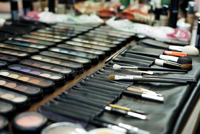 A set of various shadows, brushes and cosmetics for makeup stock images