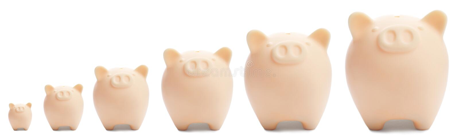 Set with different sized beige piggy banks royalty free stock photos