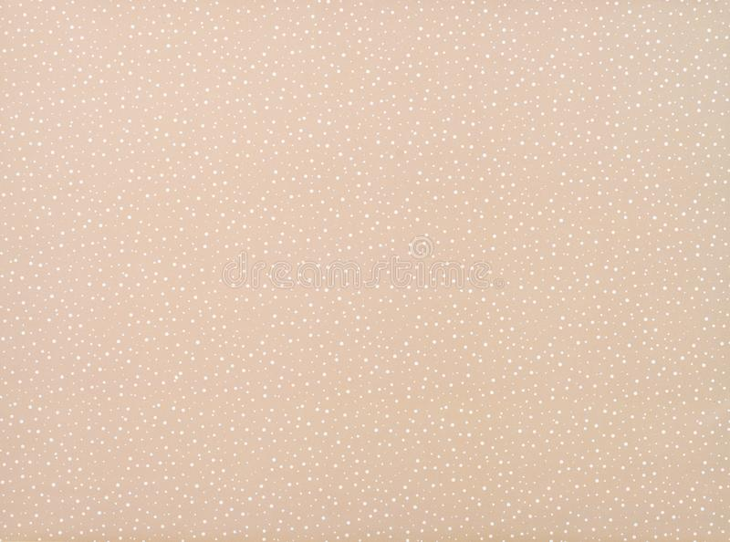 Set of different sized white circles. On beige royalty free stock image