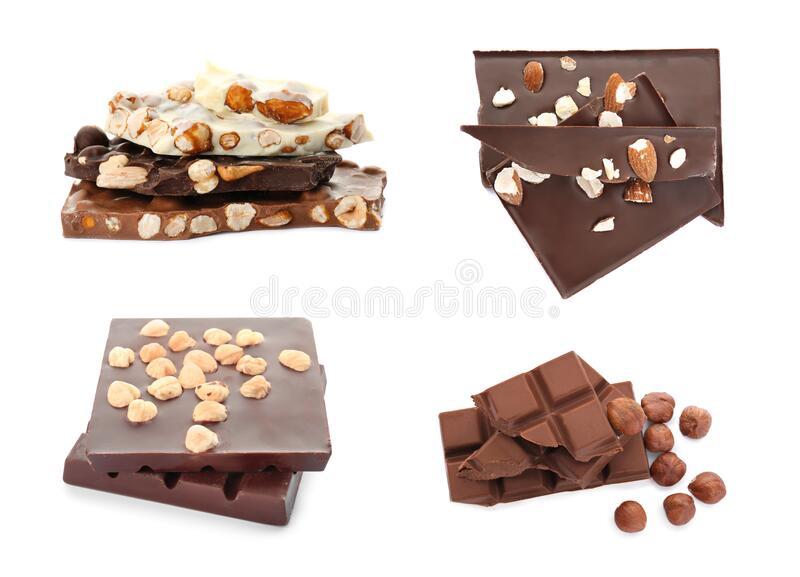 Set with different types of chocolate with nuts on background royalty free stock photo