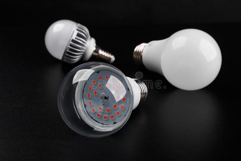 Set with different types of LED bulbs on black background royalty free stock photo