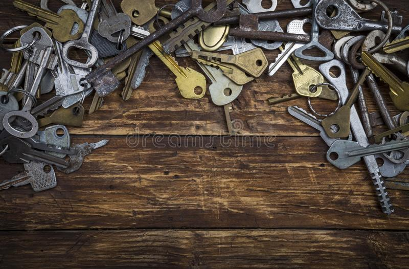 Set of different vintage keys on dark grunge wooden background. Safety and security concept, copy space royalty free stock image
