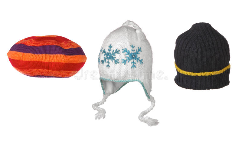 Set of different winter hats isolated on white stock photography
