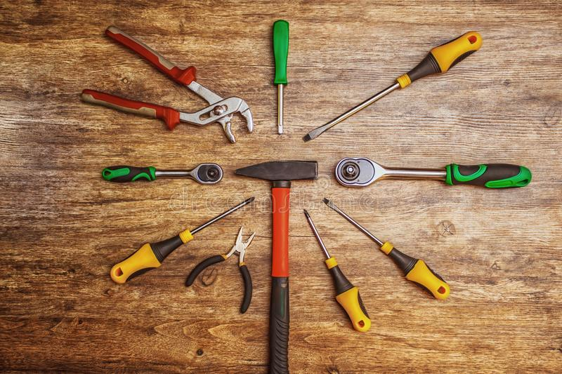 Set of different working tools on wooden background. Top view. Hand tool. Tools male workplace background texture dark wood. Copy stock photography