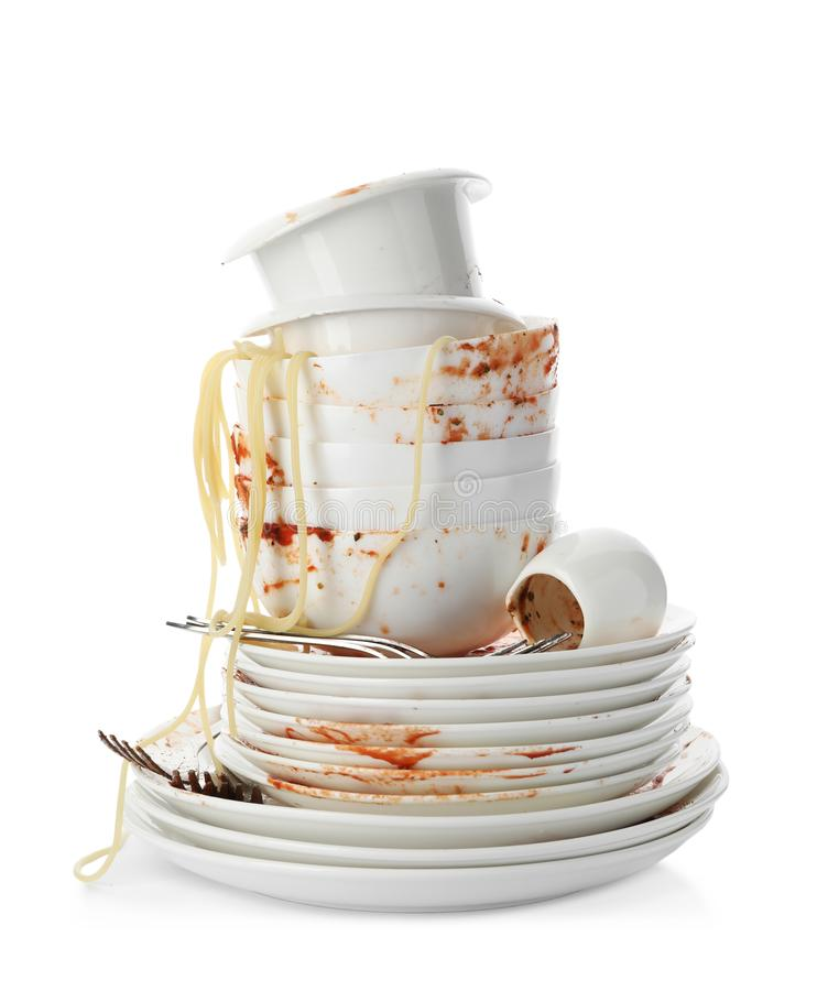 Set of dirty dishes with spaghetti leftovers on white royalty free stock photo
