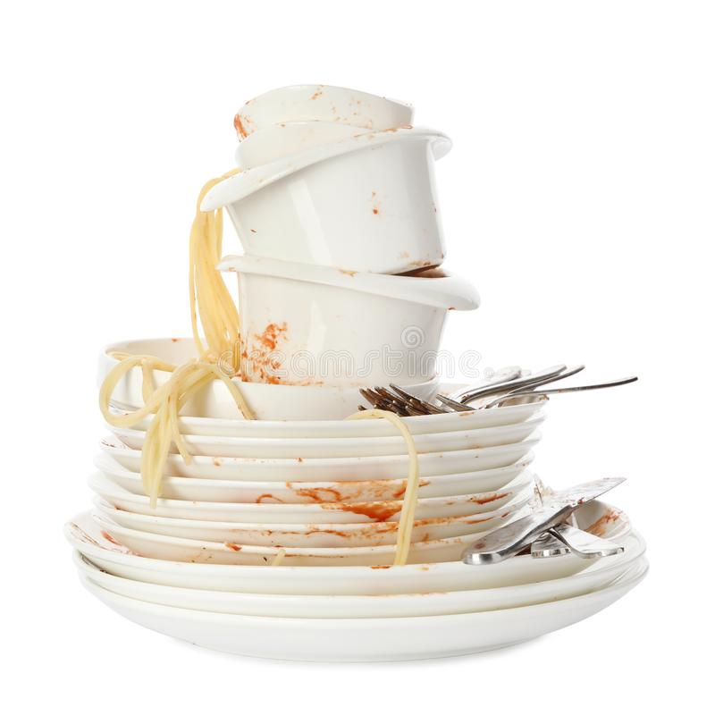 Set of dirty dishes with spaghetti leftovers on white stock images