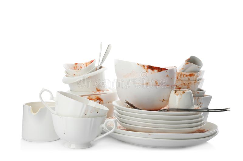Set of dirty dishes on white stock photos