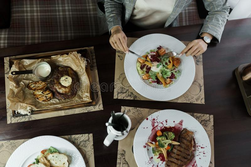 Set of dishes from: fried meat with eggplants, vegetable salad with poached egg stock photo