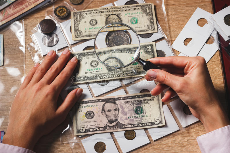 Set of dollars in the pockets through the magnifying glass stock photos