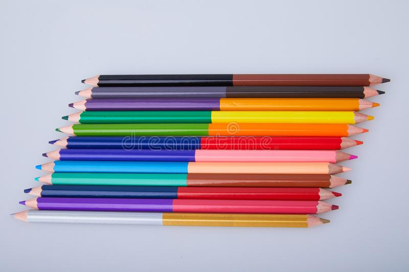 Set of double colored pencils on white background. stock photos