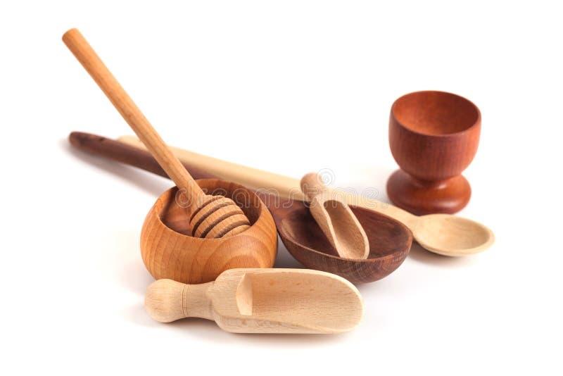 Set drewniani kuchenni naczynia odizolowywający na białym tle fotografia stock