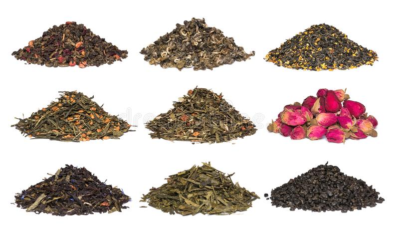 A set of dry herbal and floral tea. Green, black, composition teas on white royalty free stock images