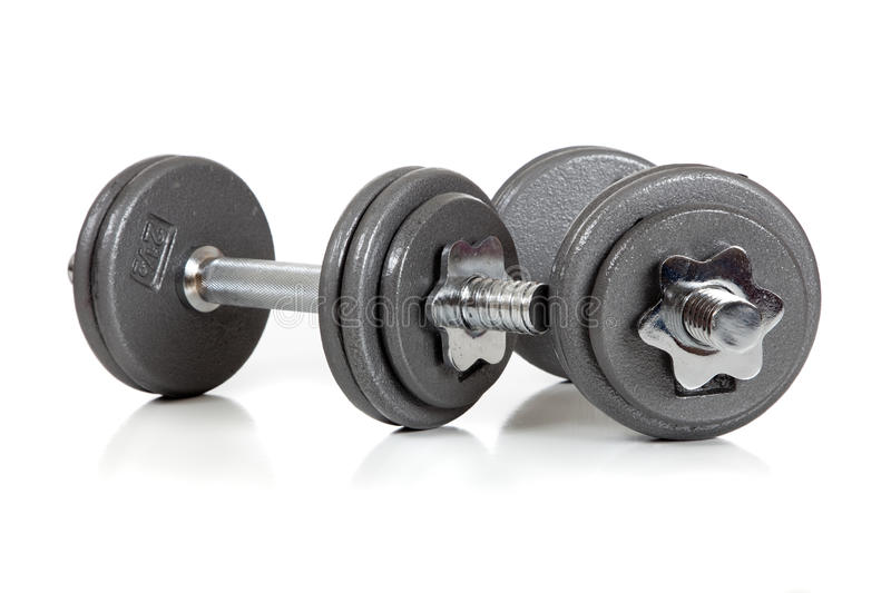 Set of dumbells on white. A set of dumbells on a white background royalty free stock photography