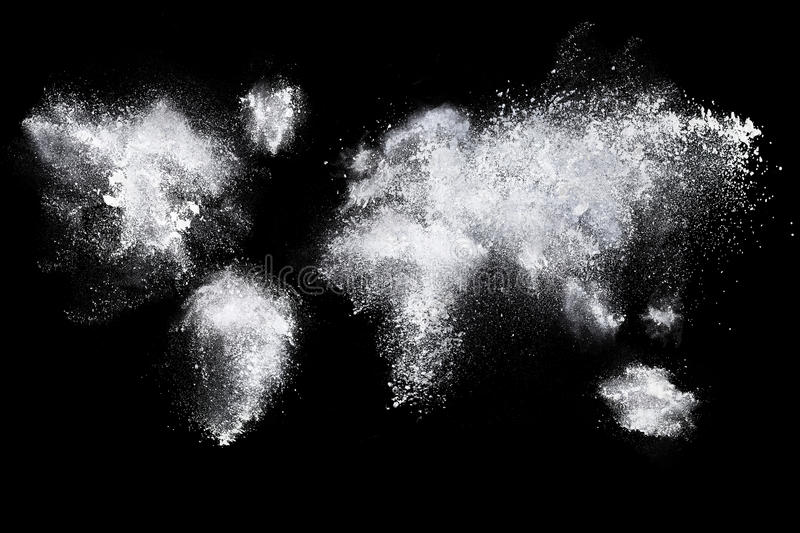 Set of dust powder clouds shaped like earth map. Set of dust powder splash clouds shaped like earth globe map isolated on black background stock image