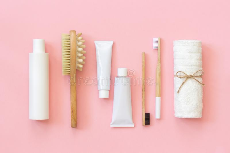 Set of eco cosmetics products and tools for shower or bath Bamboo toothbrush, natural brush, white bottles, towel accessories for royalty free stock image