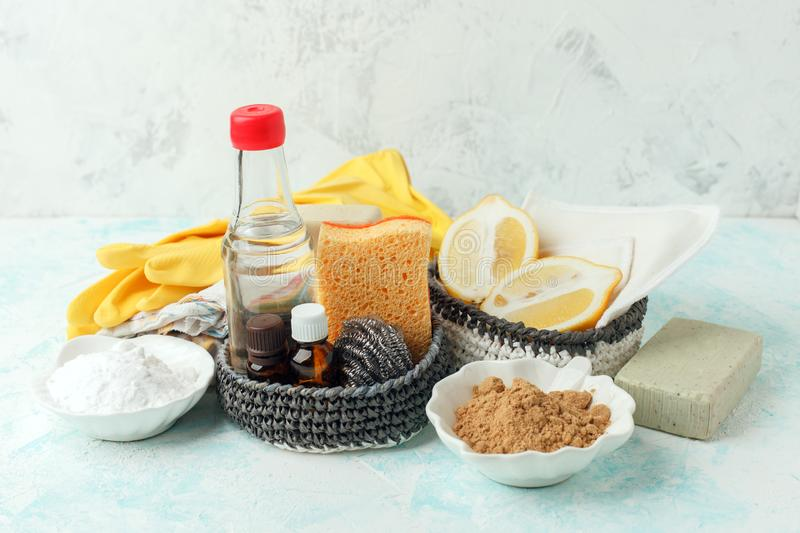 Set of eco-friendly natural cleaning products,metal brush, lemon, baking soda sodium bicarbonate, soap, essential oils, rags, stock images