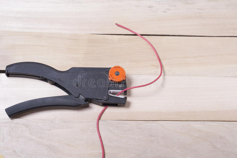 Set of electrical tool on wooden background. Accessories for engineering work, energy concept. Set of electrical tool on wooden background. Accessories for royalty free stock photo