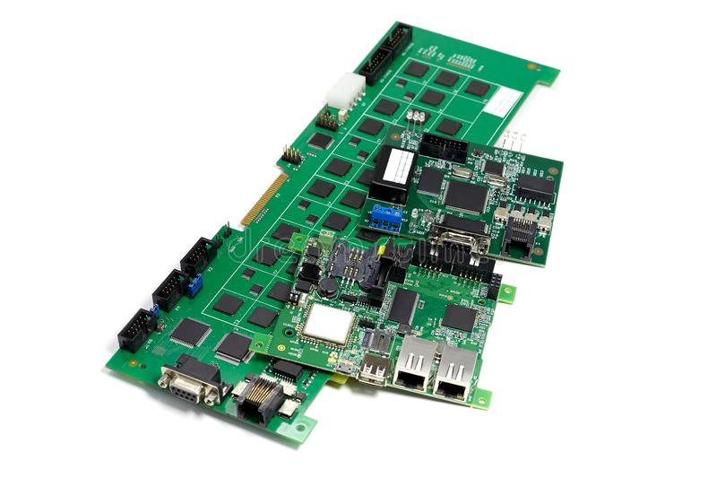 Set of electronic printed circuit boards with microchips and other components, angled view, isolated on white stock photography
