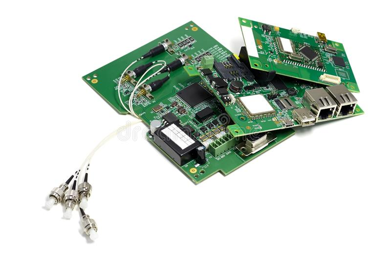 Set of electronic printed circuit boards with optic connectors attached and other components, angled view, isolated on white stock image