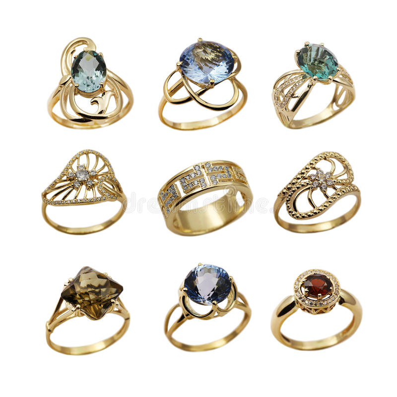 Set of elegant jewelry rings. Elegant female jewelry golden rings with jewel gems , isolated over white background stock photos