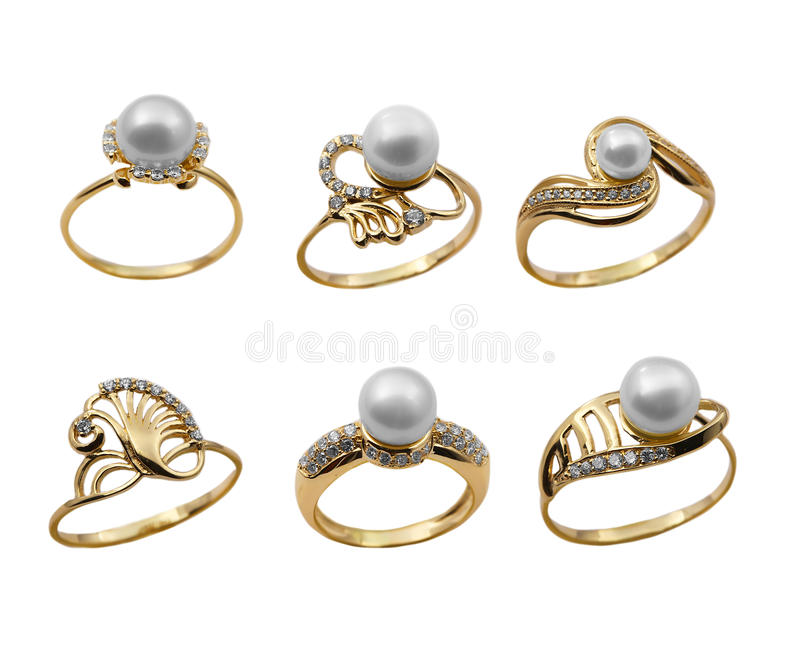 Set of elegant jewelry rings with pearl. Elegant female jewelry golden rings with jewel brilliants and pearl, isolated over white background royalty free stock photo