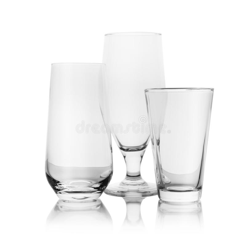 Set of empty glasses for different drinks on white royalty free stock images