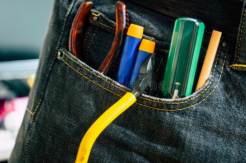Set of engineer hand tools in jeans, A jeans with engineer constructor tools. stock images